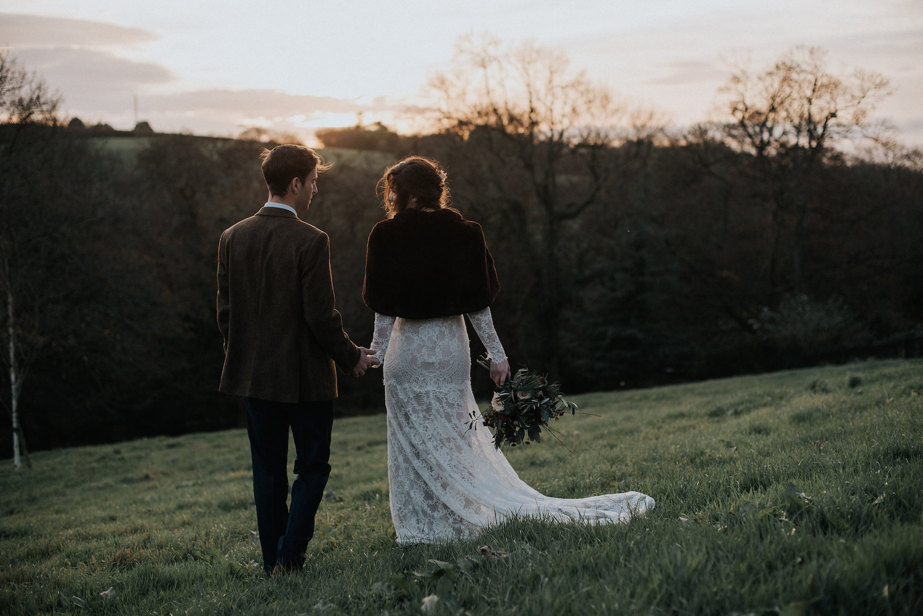 Bride and groom in the hills in Cornwall during their winter wedding