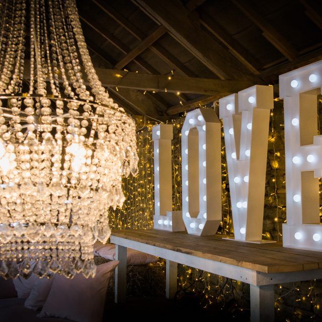 LOVE sign at a wedding at the Kingstone Estate in Devon. Alice and Tarquin planned their wedding with Jenny Wren, Wedding planner in Devon and Cornwall