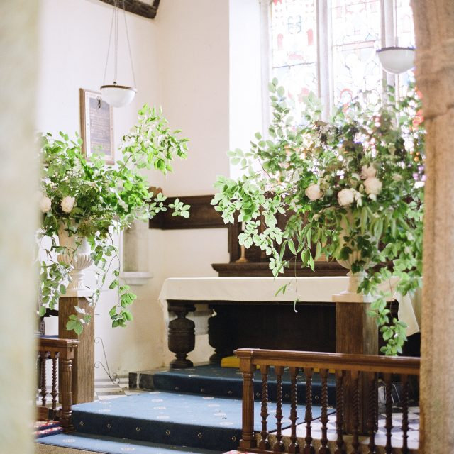 The alter and flowers at Sarah and Mark's wedding at Boconnoc House. This wedding was planned by Wedding Planner in Cornwall Jenny Wren