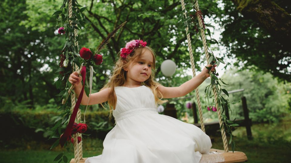 Child on a swing during a wedding in Cornwall. Wedding planned by Jenny Wren Cornwall Wedding Planner