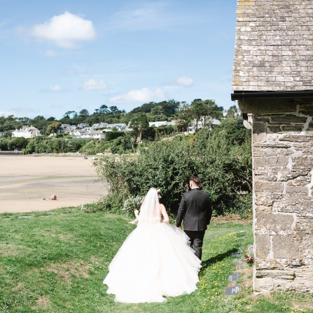 Bride and groom at St Michaels church in Rock, Cornwall