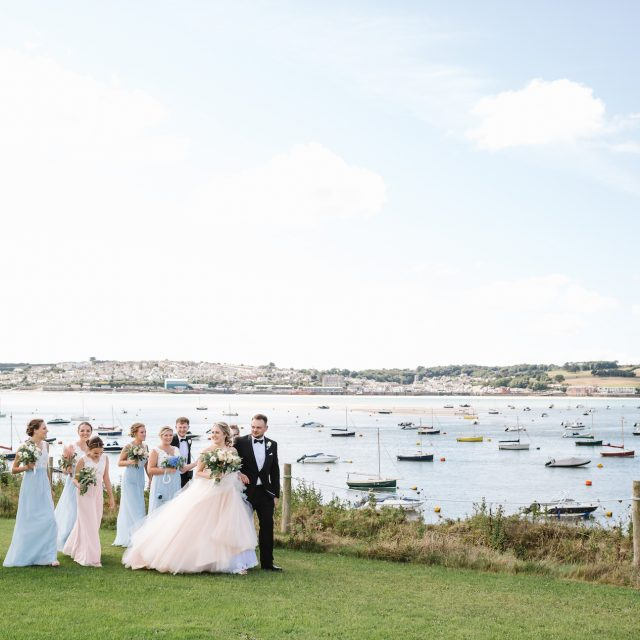 Bridal party and view at Porthilly Farm wedding in Cornwall