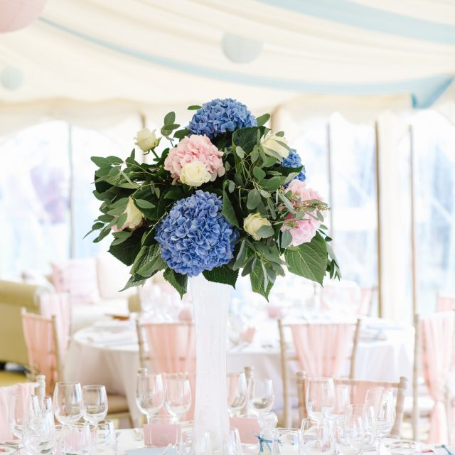 Blue and pink hydrangeas table arrangement at wedding at Porthilly Farm iin Rock, Cornwall
