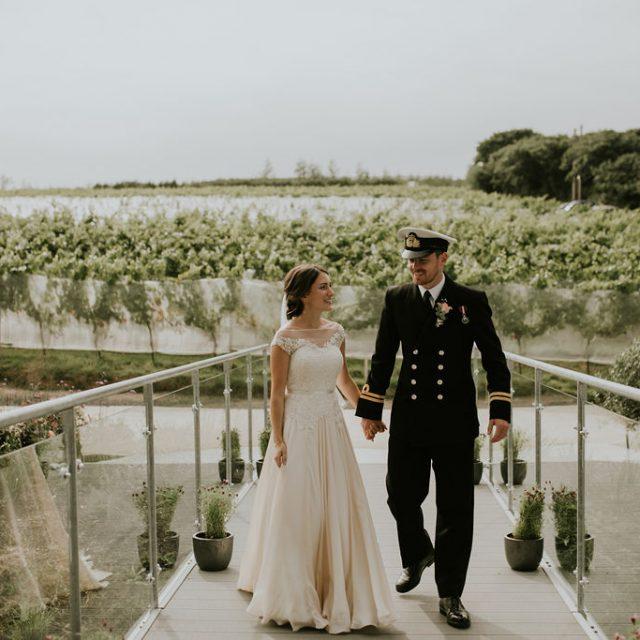 Bride and groom at vineyard at Trevibban Mill in Cornwall