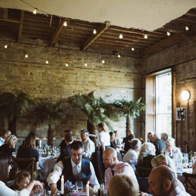 Guests having dinner at Enys House wedding in Cornwall