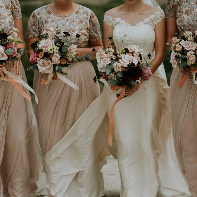 Blush pink bridesmaids dresses and blush pink bouquets at Trevibban Mill Cornwall
