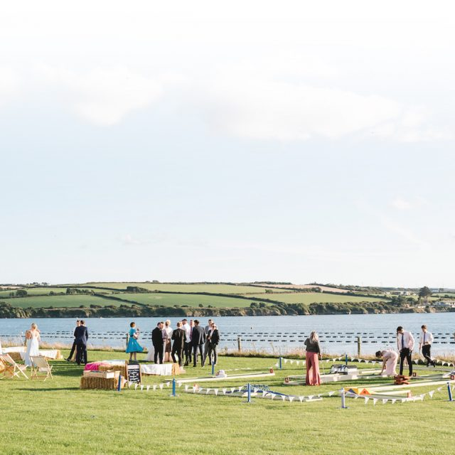 Scenic shot of some guests at a Wedding at Porthilly Farm, Cornwall. Jenny Wren Wedding Planner