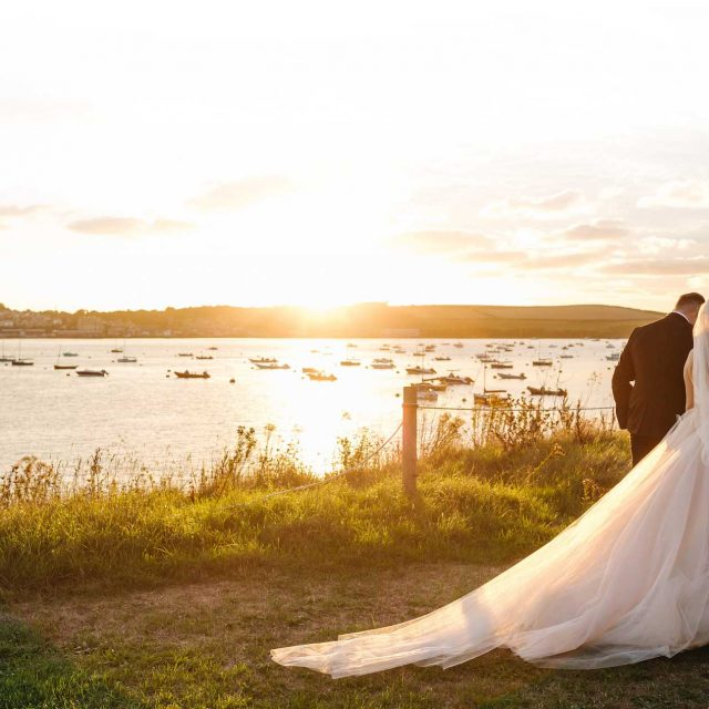 Sunset shot of Jasmin and Lewis's wedding at Porthilly Farm in Cornwall