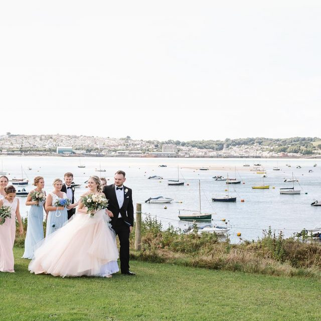 Group shot of Jasmine and Lewis's wedding at Porthilly Farm in Cornwall