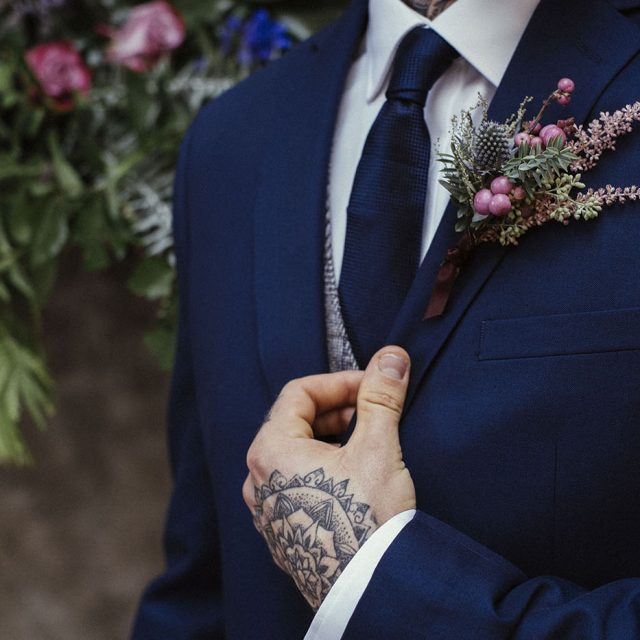 Close up of the groom's suit and tie at Oceans Studio in Plymouth during styled wedding shoot