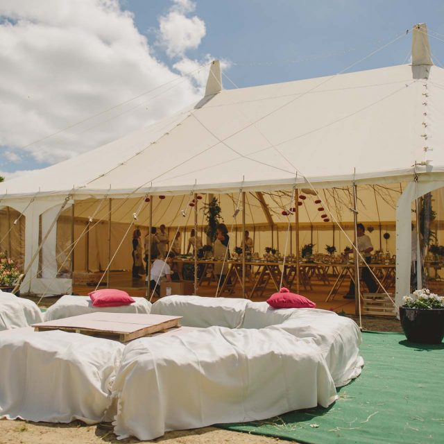 Seating and marquee set up at a private home wedding in Cornwall