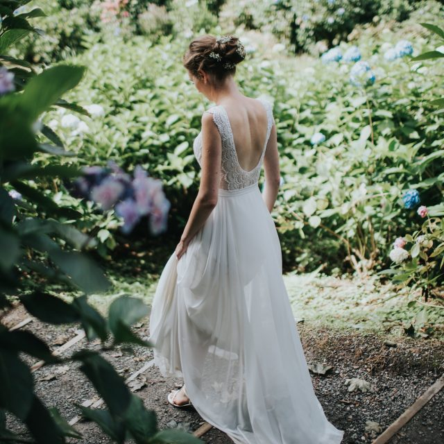 Bride walking through the woods at a wedding at Trebah Gardens in Cornwall