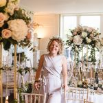 Jenny preparing the tables at a wedding at Boconnoc House in Cornwall