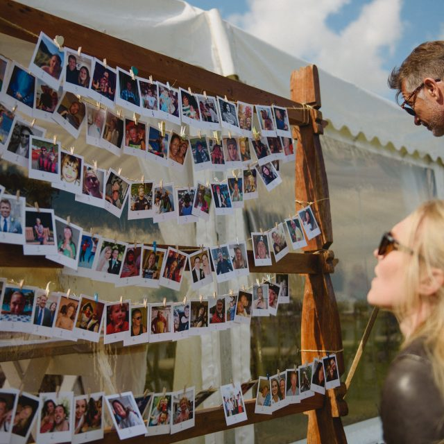 Guests studying the seating plan at a wedding at Carswell Farm in Devon