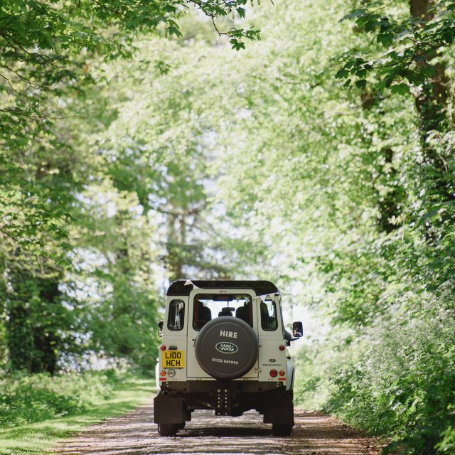 Landrover Defender in a country lane at a wedding at Carswell Farm in Devon