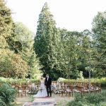 Zoomed out shot of the bride and groom from the wedding styled shoot at Boconnoc House in Cornwall