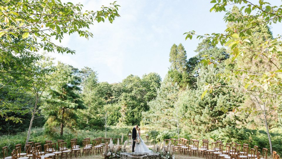 Couple in pinetum woodland wedding at Boconnoc
