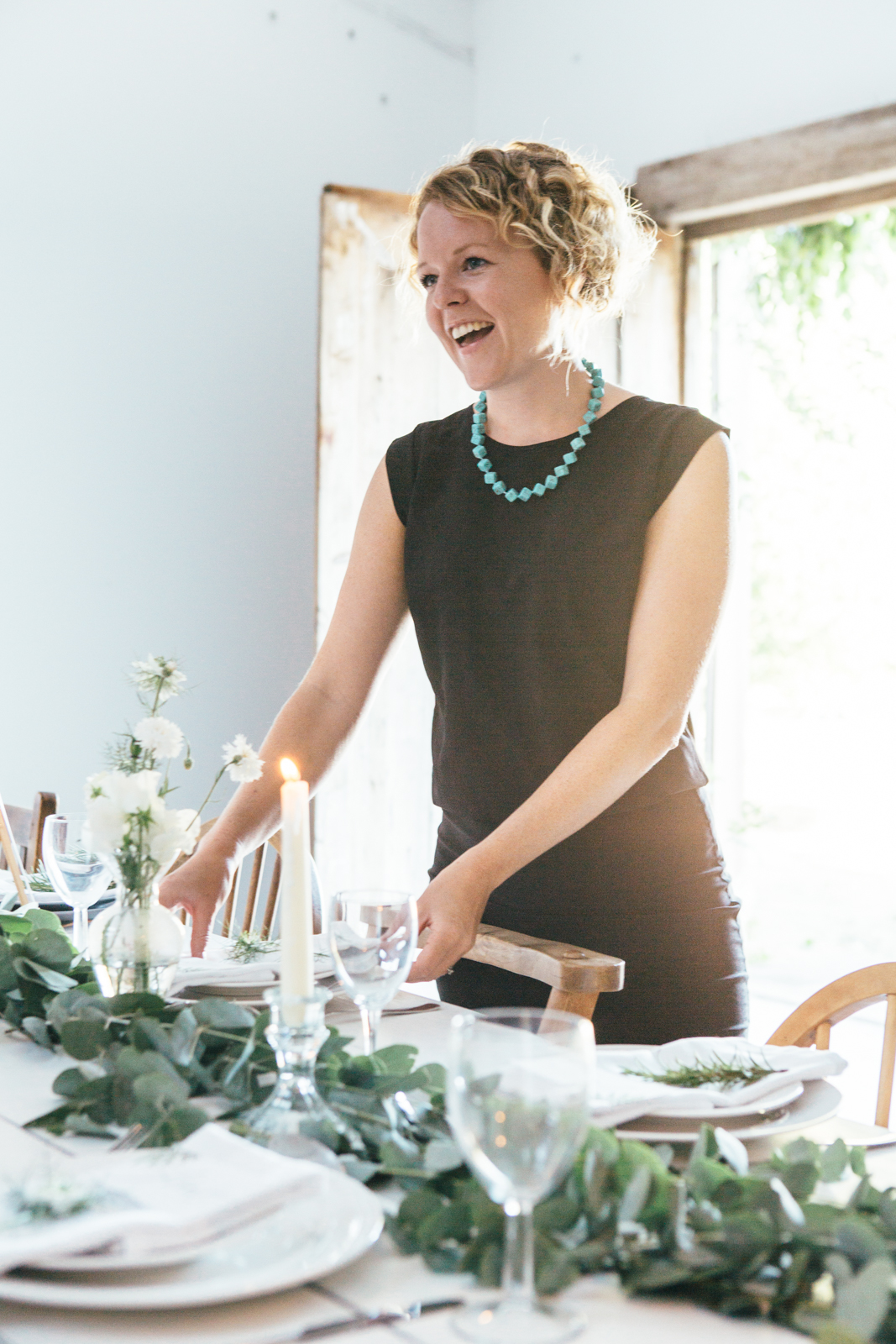 Jenny preparing a table at a real wedding in Cornwall as she's working as a wedding planner